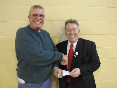 Michael Gravelle, MPP purchasing his Terrace Bay Seniors Membership from Vice President, Doug Roberts
